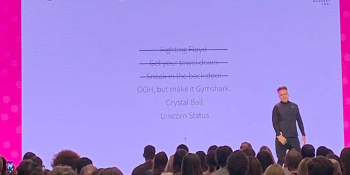 gymshark marketing, on stage at MAD//Fest london, old truman brewery, giving a speech on brand growth